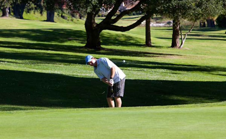 A golfer plays a hole on the course at Blacklake Golf Resort